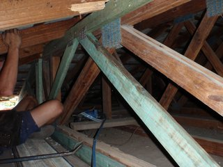 Building Inspection taking place inside roof
